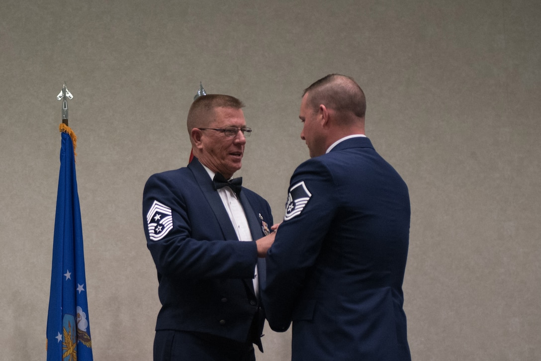 Master Sgt. Jason Sanderson, aircraft mechanic for the 123rd Airlift Wing, receives the Kentucky Enlisted Exceptional Performance Award from Chief Master Sgt. Jeff Moore, Kentucky's state command chief, during the Soldier and Airman of the Year banquet at the Kentucky Fair and Exposition Center, Louisville, Ky. on March 4, 2017. The winners were selected for their leadership and performance in their primary duties, dedication to self-improvement, and base and community involvement. (U.S. Air National Guard photo by Staff Sgt. Joshua Horton)