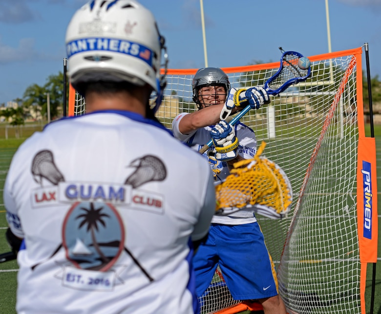 U.S. Navy Seaman Benton Lamendola, a member of the Guam Black Tips Lacrosse team, practices goalie drills Jan. 8, 2016, at Andersen Air Force Base, Guam. The Guam Black Tips lacrosse team has brought together service members from different branches to train and play lacrosse. Lamendola is a hull maintenance technician fireman in the repair department of the U.S.S Emory S. Land. (U.S. Air Force photo by Airman 1st Class Gerald R. Willis)