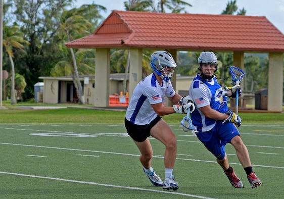 U.S. Air Force Airman 1st Class Ryan Muller, left, a member of the Guam Black Tips Lacrosse team, plays defense against Navy Seaman Benton Lamendola, right, during a scrimmage Jan. 8, 2016, at Andersen Air Force Base, Guam. The Guam Black Tips lacrosse team has brought together service members from different branches and civilians to train and play lacrosse. (U.S. Air Force photo by Airman 1st Class Gerald R. Willis)