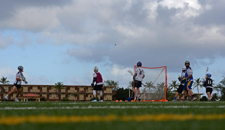U.S. Air Force and Navy members of the Guam Black Tips lacrosse team scrimmage during practice Jan. 8, 2016, at Andersen Air Force Base, Guam. The Black Tips practice and travel to tournaments in the Indo-Asian-Pacific Region to represent Guam. (U.S. Air Force photo by Airman 1st Class Gerald R. Willis)