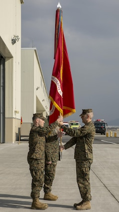 U.S. Marine Corps Sgt. Maj. Jason L. Kappen, right, Marine Fighter Attack Squadron (VMFA) 121 sergeant major, passes the squadron guidon to U.S. Marine Corps Lt. Col. J.T. Bardo, outbound VMFA-121 commanding officer, during a change of command ceremony at Marine Corps Air Station Iwakuni, Japan, March 3, 2017. The passing of the guidon symbolizes the transfer of Bardo's role as commanding officer to U.S. Marine Corps Lt. Col. Richard M. Rusnok Jr., after serving as the squadron commander since August 2015. (U.S. Marine Corps photo by Cpl. Aaron Henson)