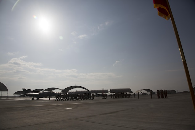Marines, Sailors and civilian personnel gather on Marine Corps Air Station Iwakuni, Japan, to observe a change of command ceremony for Marine Fighter Attack Squadron (VMFA) 121, March 3, 2017.  Lt. Col. J.T. Bardo, outgoing commanding officer of VMFA-121, led the squadron during their move from Marine Corps Air Station Mirimar, California to MCAS Iwakuni and transferred the command to Lt. Col. Richard M. Rusnok Jr. (U.S. Marine Corps photo by Lance Cpl. Jacob A. Farbo)