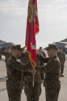 U.S. Marine Corps Lt. Col. Richard M. Rusnok Jr., oncoming commanding officer of Marine Fighter Attack Squadron (VMFA) 121, receives the VMFA-121 guidon from Lt. Col. J.T. Bardo, outgoing commanding officer of VMFA-121, on Marine Corps Air Station Iwakuni, Japan, March 3, 2017. The passing of the guidon is a Marine Corps tradition signifying the passing on of the commanding officer billet. (U.S. Marine Corps photo by Lance Cpl. Jacob A. Farbo)