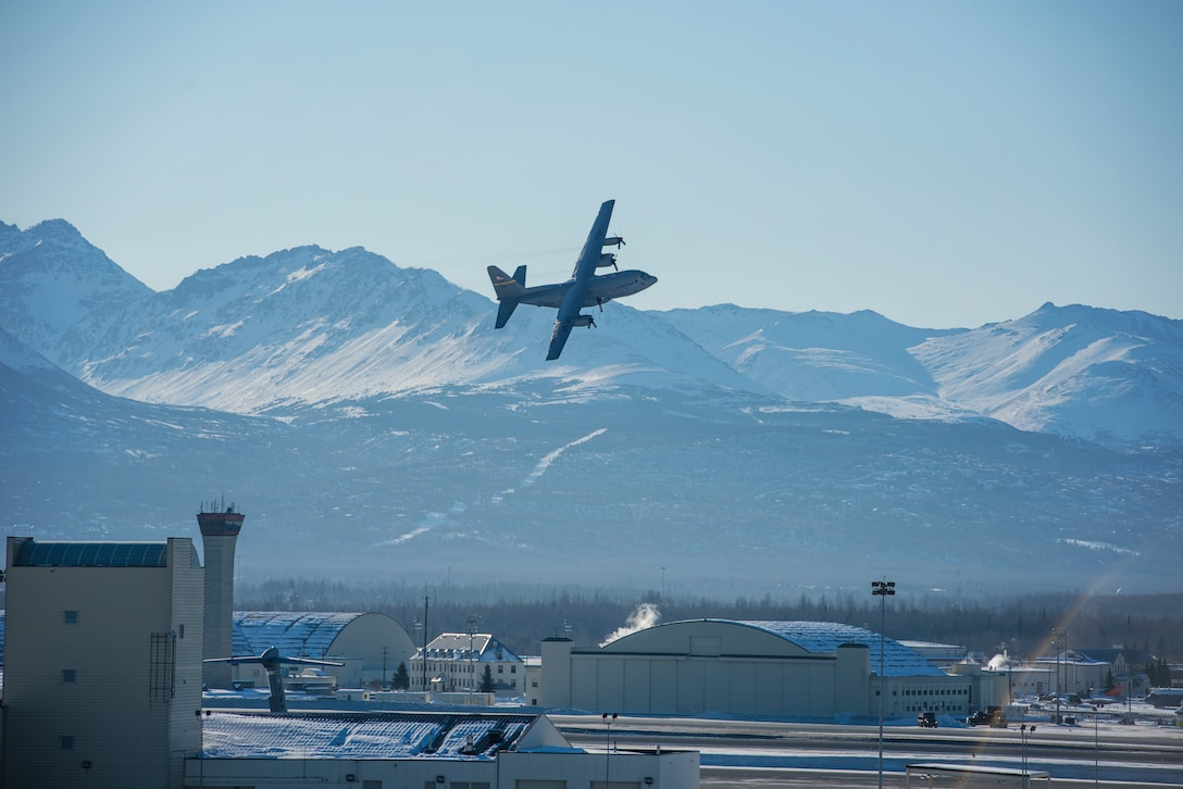 A C-130 Hercules aircraft from the 144th Airlift Squadron takes off for the last time from Joint Base Elmendorf-Richardson, Alaska, March 5, 2017. After 41 years of flying the C-130 aircraft, the 144th Airlift Squadron's 12 C-130s were divested, with the planes either being transferred to outside units or retired from service. The final two C-130H airframes departed on this date. (U.S. Air National Guard photo by Staff Sgt. Edward Eagerton/released)