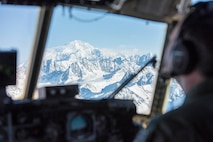Denali, the highest point in North America, looms outside the window of a C-130 Hercules aircraft from the 144th Airlift Squadron, Alaska Air National Guard, March 4, 2017. After 41 years of flying the C-130 aircraft, the 144th Airlift Squadron's 12 C-130s were divested, with the planes either being transferred to outside units or retired from service. The unit's last two aircraft departed Joint Base Elmendorf-Richardson, Alaska, the following day. (U.S. Air National Guard photo by Staff Sgt. Edward Eagerton/released)