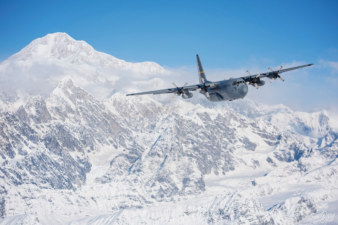 A C-130 Hercules from the 144th Airlift Squadron, Alaska Air National Guard, flies away from Denali, the highest point in North America, March 4, 2017. After 41 years of flying the C-130 aircraft, the 144th Airlift Squadron's 12 C-130s were divested, with the planes either being transferred to outside units or retired from service. The unit's last two aircraft departed Joint Base Elmendorf-Richardson, Alaska, the following day. (U.S. Air National Guard photo by Staff Sgt. Edward Eagerton/released)