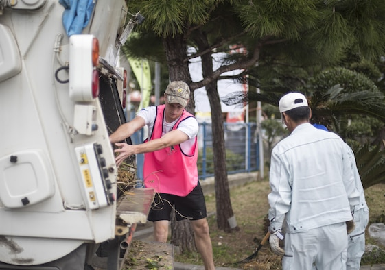 U.S. Air Force Senior Airman Marcus Lollis, 909th Aircraft Maintenance Unit integrated flight control systems journeyman, helps dispose of landscaping debris from a volunteer event at Yara Elementary School March 5, 2017, at Kadena Town, Japan. Airmen from the 909th AMU volunteer often in Kadena Town to give back to the local community. (U.S. Air Force photo by Senior Airman Omari Bernard/Released)