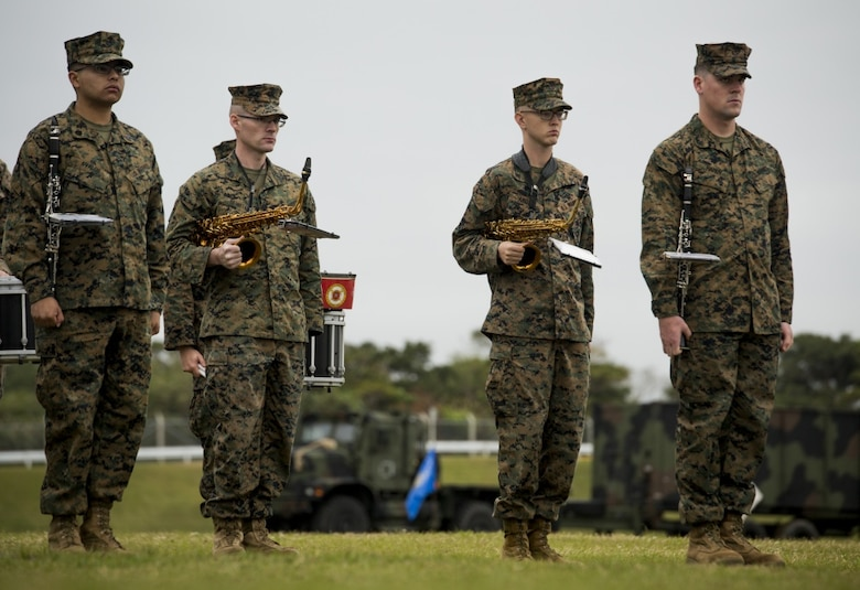 Staff Sgt. Michael Newell, a saxophone instrumentalist with III Marine Expeditionary Force Band, performed during a Combat Logistics Battalion 31 relief and appointment ceremony at Camp Hansen, Okinawa, Japan, Feb. 24, 2017. The III MEF Band is the only forward-deployed band in the Marine Corps, performing across the Asia-Pacific Region. (U.S. Marine Corps photo by Lance Cpl. Andy Martinez)