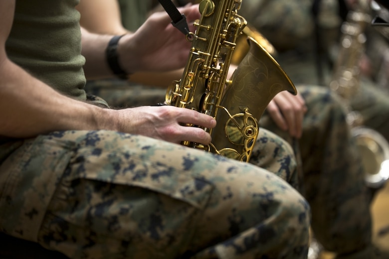 Staff Sgt. Michael Newell, a saxophone instrumentalist with III Marine Expeditionary Force Band, rehearses alongside his fellow Marines at the III MEF Band Hall aboard Camp Foster, Okinawa, Japan, March 1, 2017. At age 12, Newell began practicing the saxophone. Newell was recognized for his musical talents, Marine Corps accomplishments and nominated for Marine Corps Staff Noncommissioned Officer Musician of the Year. (U.S. Marine Corps photo by Lance Cpl. Andy Martinez)