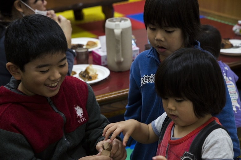 Three local Okinawan children play jenga during a community outreach event, March 3, 2017, at Yugafu Church, in Okinawa, Japan. Marines and Sailors with 3D Marine Expeditionary Brigade provided food for less fortunate children during the event. For Thanksgiving, the 3D MEB volunteers served food to 100 people at the church. (U.S. Marine Corps photo by Cpl. Samantha Villarreal/Released)