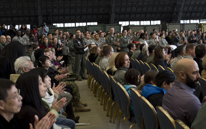 Ceremony attendees clap during a C-130J Super Hercules arrival ceremony at Yokota Air Base, Japan, March 6, 2016. Much like its H-model older brother, the C-130J will be used to support critical peacekeeping and contingency operations in the Indo-Asia Pacific region, including cargo delivery, troop transport, airdrop and aeromedical missions. (U.S. Air Force photo by Staff Sgt. David Owsianka)