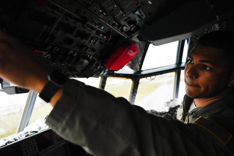 Tech. Sgt. Napoleon Ortiz, 36th Airlift Squadron loadmaster, performs a preflight inspection of a C-130J Super Hercules at Kadena Air Base, Japan, March 6, 2017. This is the first C-130J to be assigned to Pacific Air Forces. Yokota serves as the primary Western Pacific airlift hub for U.S. Air Force peacetime and contingency operations. Missions include tactical air land, airdrop, aeromedical evacuation, special operations and distinguished visitor airlift. (U.S. Air Force photo by Staff Sgt. Michael Smith)
