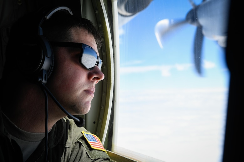 A loadmaster with the 36th Airlift Squadron, performs a visual conformation over the Pacific Ocean, March 6, 2017. This is the first C-130J to be assigned to Pacific Air Forces. Yokota serves as the primary Western Pacific airlift hub for U.S. Air Force peacetime and contingency operations. Missions include tactical air land, airdrop, aeromedical evacuation, special operations and distinguished visitor airlift. (U.S. Air Force photo by Staff Sgt. Michael Smith)