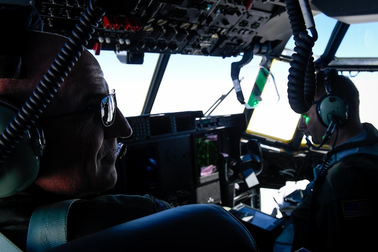 Col. Kenneth Moss, 374th Airlift Wing commander, communicates with his crew members over the Pacific Ocean, March 6, 2017. This is the first C-130J to be assigned to Pacific Air Forces. Yokota serves as the primary Western Pacific airlift hub for U.S. Air Force peacetime and contingency operations. Missions include tactical air land, airdrop, aeromedical evacuation, special operations and distinguished visitor airlift. (U.S. Air Force photo by Staff Sgt. Michael Smith)
