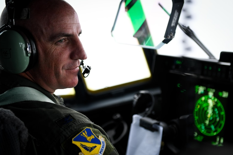 Col. Kenneth Moss, 374th Airlift Wing commander, flies over the Pacific Ocean, March 6, 2017. This is the first C-130J to be assigned to Pacific Air Forces.  Yokota serves as the primary Western Pacific airlift hub for U.S. Air Force peacetime and contingency operations. Missions include tactical air land, airdrop, aeromedical evacuation, special operations and distinguished visitor airlift. (U.S. Air Force photo by Staff Sgt. Michael Smith)