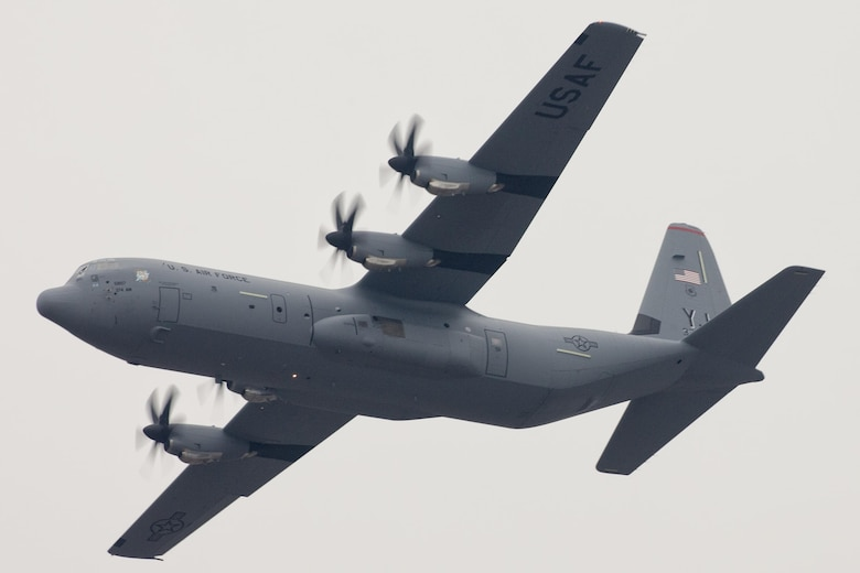 A C-130J Super Hercules flies over Yokota Air Base, Japan, March 6, 2017. This is the first C-130J to be assigned to Pacific Air Forces. Yokota serves as the primary Western Pacific airlift hub for U.S. Air Force peacetime and contingency operations. Missions include tactical air land, airdrop, aeromedical evacuation, special operations and distinguished visitor airlift.(U.S. Air Force photo by Yasuo Osakabe)