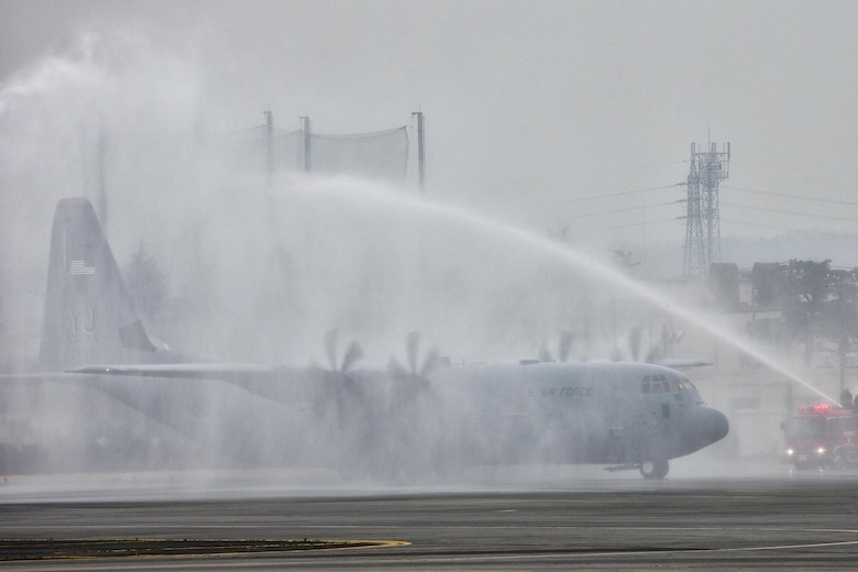A C-130J Super Hercules gives a water salute at Yokota Air Base, Japan, March 6, 2017. This is the C-130J first Super Hercules to be stationed in the Pacific. This is the first C-130J to be assigned to Pacific Air Forces. Yokota serves as the primary Western Pacific airlift hub for U.S. Air Force peacetime and contingency operations. Missions include tactical air land, airdrop, aeromedical evacuation, special operations and distinguished visitor airlift.(U.S. Air Force photo by Yasuo Osakabe)