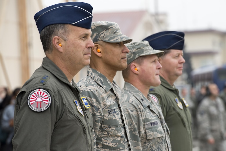Lt. Gen. Jerry Martinez, U.S. Forces Japan and 5th Air Force commander, wears the new C-130J Super Hercules patch during a ceremony held to celebrate the arrival of Yokota's newest aircraft at Yokota Air Base, Japan, Mar. 6, 2017. The aircraft provides significant performance improvements and added operational capabilities that translate directly into increased effectiveness. (U.S. Air Force photo by Senior Airman David C. Danford)