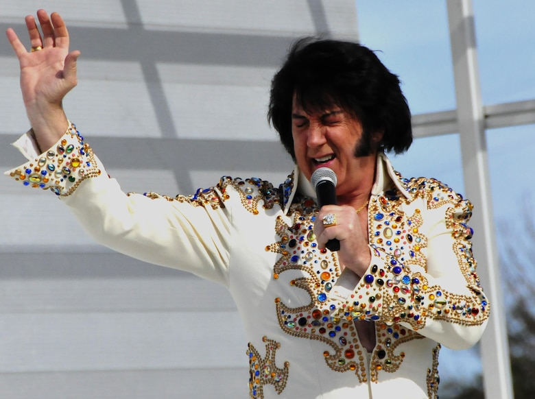 An Elvis impersonator belts out a tune during the 919th Special Operations Wing's annual Wing Day March 4 at Duke Field, Fla.  The wing sets aside a special day each year to show appreciation for its reservists and their family members. Events included music, food, children's games, etc.