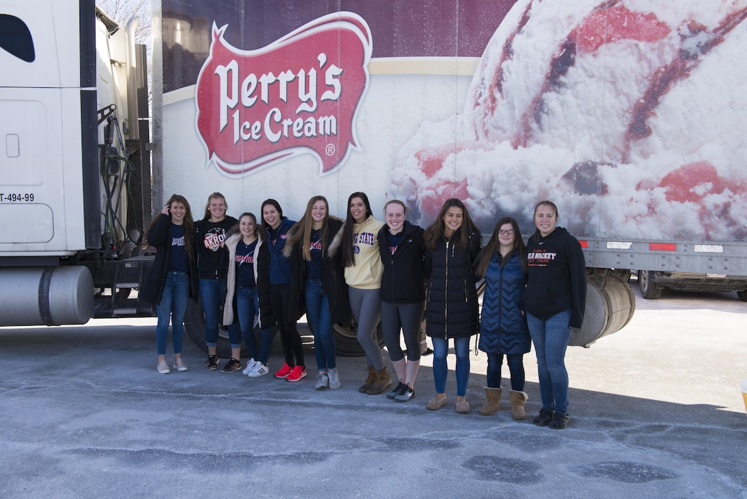 Girls from the Akron Varsity and Amherst Lightning softball teams pose Feb. 4, 2017 in front of a Perry's truck at the Niagara Falls Air Reserve Station, N.Y.  The truck was used to transfer nearly 6,000 lbs of donated softball equipment destined for the Dominican Republic.  The equipment is being transferred to its destination by a C-130 out of Niagara, through a program called Denton Cargo. (U.S. Air Force photo by Tech. Sgt. Stephanie Sawyer)