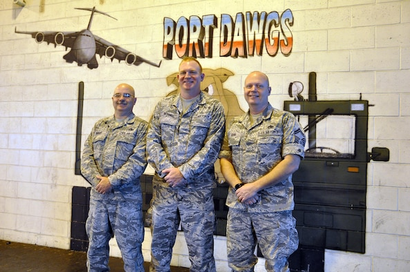 Senior Master Sgt. Paul Wright, Master Sgt. David Worrell and Senior Master Sgt. Steve Adams, all members of the 87th Aerial Port Squadron, have more than 50 years of service at the 445th Airlift Wing. These Airmen are retiring this year. (U.S. Air Force photo/Staff Sgt. Rachel Ingram)