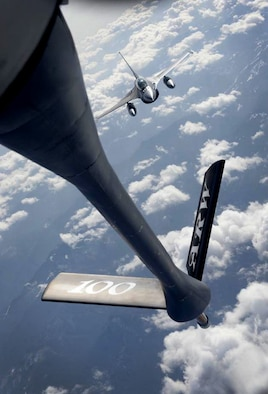 A Romanian air force F-16 Fighting Falcon approaches a U.S. Air Force KC-135 Stratotanker refueling boom Feb. 28, 2017, during air refueling training over Bucharest, Romania. The 100th Air Refueling Wing from RAF Mildenhall, England, travelled to Bucharest to train and certify the RoAF F-16 Fighting Falcon fleet on air refueling with a U.S. tanker. (U.S. Air Force photo by Staff Sgt. Kate Thornton)