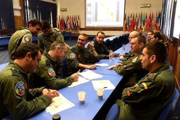 Aircrew from the U.S. and Romanian air forces discuss flight plans during the first air refueling training between the two countries Feb. 27, 2017, in Bucharest, Romania. The crew from the 100th Air Refueling Wing from Royal Air Force Mildenhall, England, travelled to Bucharest to train and certify the Romanian Air Force F-16 Fighting Falcon fleet on air refueling with a U.S. tanker. (U.S. Air Force photo/Staff Sgt. Kate Thornton)
