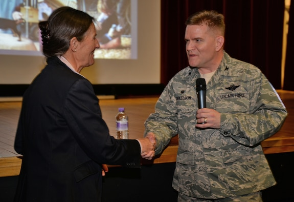 Air Force Col. Thomas D. Torkelson, the 100th Air Refueling Wing commander, thanks retired Army Brig. Gen. Rhonda Cornum for telling her story March 2, 2017, at the base theater on Royal Air Force Mildenhall, England. Cornum is the founder of the Comprehensive Soldier Fitness program which helps soldiers cope when a stressful situation occurs. (U.S. Air Force photo/Senior Airman Christine Halan)