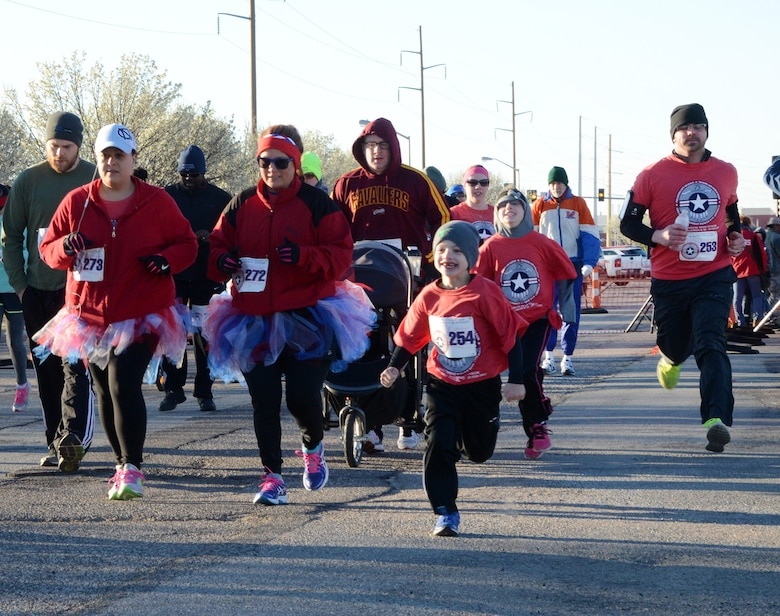People of all ages participated in Tinker's 75th Anniversary Half Marathon and 5K Feb. 25. The Calvert family, all wearing their red event T-shirts, ran the 5K together. (Air Force photo by Kelly White)
