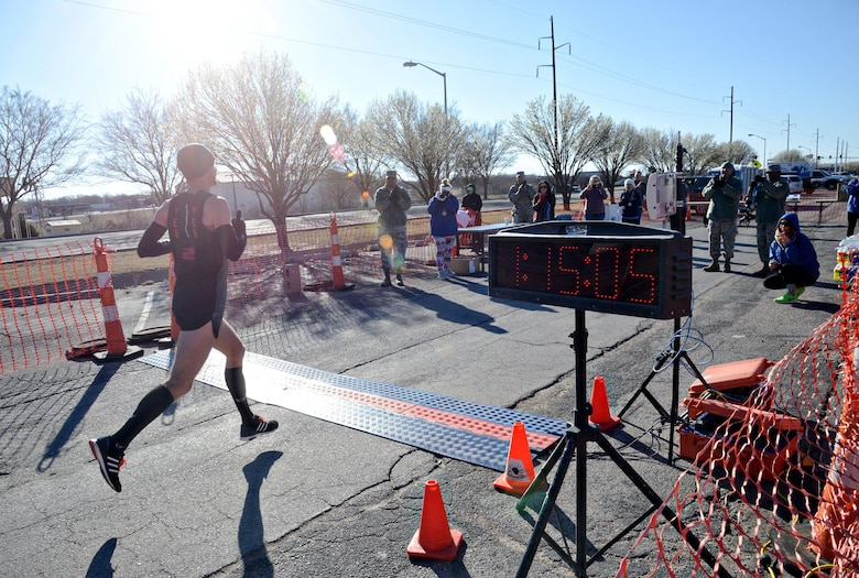 Jason Butler, a tool maker with the 553rd Commodities Maintenance Group, was the first place finisher in the 75th Anniversary Half Marathon, with a final time of 1:15:06.  (Air Force photo by Kelly White)