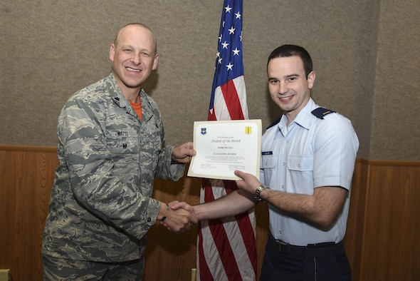 U.S. Air Force Lt. Col. Steven Watts, 17th Training Group Deputy Commander, presents the 315th Officer Training Squadron Student of the Month award for Febuary 2017 to 2nd Lt. Daniel Jensen, 315th TRS student, in the Brandenburg Hall on Goodfellow Air Force Base, Texas, March 3, 2017. (U.S. Air Force photo by Airman 1st Class Chase Sousa/Released)