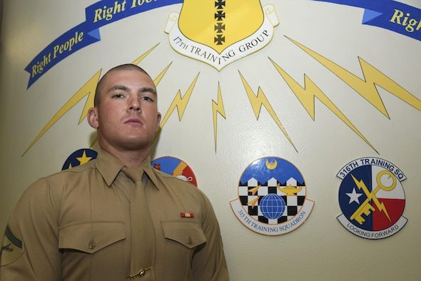 U.S. Marine Corps Lance Cpl. Michael Coleman, 316th Training Squadron student, stands for a portrait at Brandenburg Hall on Goodfellow Air Force Base, Texas, March 3, 2017. Coleman is the Goodfellow Student of the Month spotlight for February 2017, a series highlighting Goodfellow students. (U.S. Air Force photo by Airman 1st Class Chase Sousa/Released)