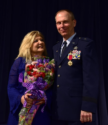 From left, Florence Deputy receives a bouquet of flowers from her husband Brig. Gen. David Deputy, director of joint staff, Delaware National Guard, for her support during his 40+ years of service. Brig. Gen. Deputy retired during a ceremony honoring his service to the state and the nation, New Castle, De., March 5, 2017. (U.S. Air National Guard photo by SSgt. Andrew Horgan)