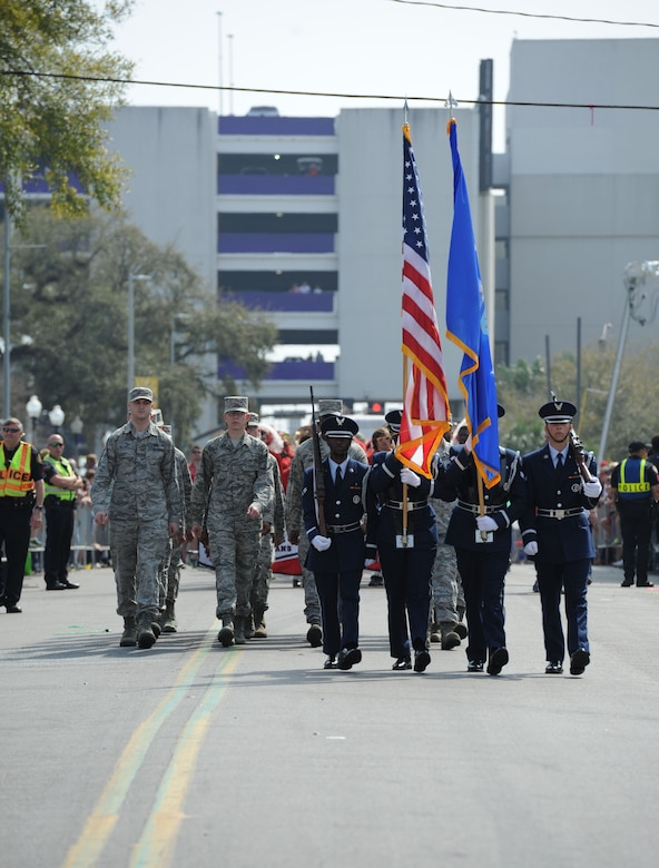 Members of the Keesler Air Force Base Honor Guard lead the Gulf Coast Carnival Association Mardi Gras parade Feb. 28, 2017, in Biloxi, Miss. Every Mardi Gras season, Keesler personnel participate in local parades to show their support of the communities surrounding the installation. (U.S. Air Force photo by Kemberly Groue)