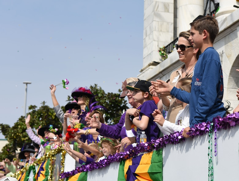 Col. Michele Edmondson, 81st Training Wing commander, and her son, Callahan McGowan, attend the Gulf Coast Carnival Association Mardi Gras parade Feb. 28, 2017, in Biloxi, Miss. Every Mardi Gras season, Keesler personnel participate in local parades to show their support of the communities surrounding the installation. (U.S. Air Force photo by Kemberly Groue)
