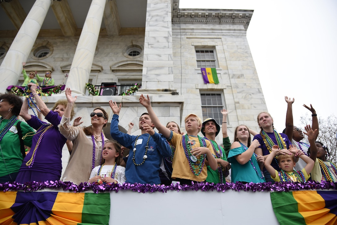 Keesler leadership and their families attend the Gulf Coast Carnival Association Mardi Gras parade Feb. 28, 2017, in Biloxi, Miss. Every Mardi Gras season, Keesler personnel participate in local parades to show their support of the communities surrounding the installation. (U.S. Air Force photo by Kemberly Groue)