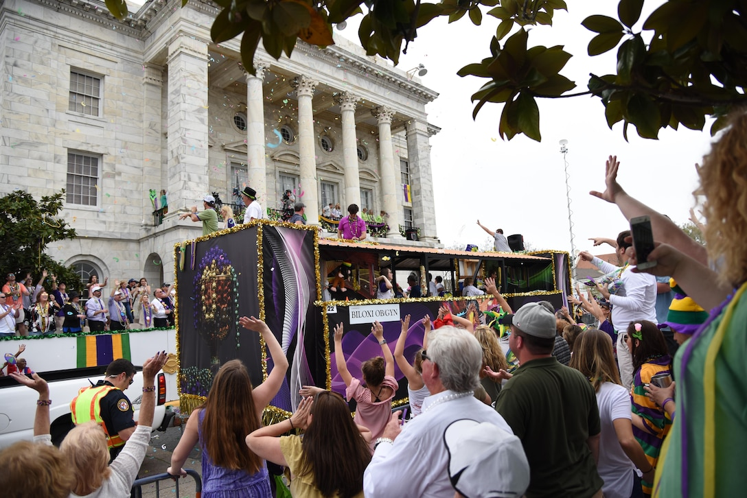 A float passes in front of Biloxi City Hall during the Gulf Coast Carnival Association Mardi Gras parade Feb. 28, 2017, in Biloxi, Miss. Every Mardi Gras season, Keesler personnel participate in local parades to show their support of the communities surrounding the installation. (U.S. Air Force photo by Kemberly Groue)