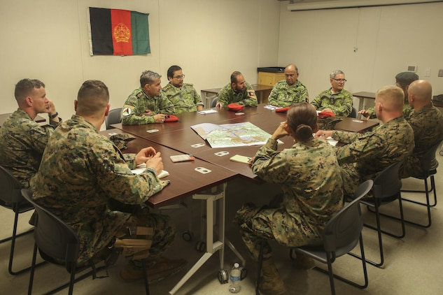 Afghan role players and Marines with Task Force Southwest hold an advisory meeting during a full mission rehearsal at Camp Lejeune, N.C., Feb. 28, 2017. Approximately 300 Marines with the unit enhanced their advisory, rapport-building and combat skills during the week-long exercise in preparation for an upcoming deployment to Helmand Province, Afghanistan. Marines with Task Force Southwest will train, advise and assist the Afghan National Army 215th Corps and 505th Zone National Police. (U.S. Marine Corps photo by Sgt. Lucas Hopkins)