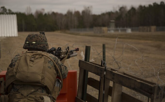 A Marine with Task Force Southwest scans the area for an enemy threat during the full mission rehearsal at forward operating base Bravo, Camp Lejeune, N.C., Feb. 28, 2017. The Marines worked with Afghan role players to gain better cultural understanding before deploying later this year to Helmand Province, Afghanistan. The Marines are scheduled to deploy as part of the task force to train, advise and assist the Afghan National Army 215th Corps and 505th Zone National Police. (U.S. Marine Corps photo by Sgt. Justin T. Updegraff)