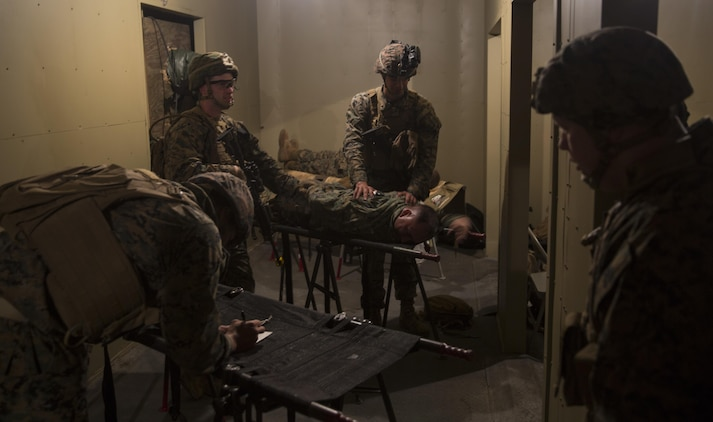 Marines with Task Force Southwest calm a notional casualty during a mass casualty drill during the full mission rehearsal at forward operating base Bravo, Camp Lejeune, N.C., Feb. 28, 2017. The Marines are scheduled to deploy later this year as part of the task force to train, advise and assist the Afghan National Army 215th Corps and 505th Zone National Police in Helmand Province, Afghanistan. (U.S. Marine Corps photo by Sgt. Justin T. Updegraff)