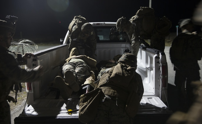 Marines with Task Force Southwest load two notional casualties during a mass casualty drill during the final mission rehearsal at forward operating base Bravo, Camp Lejeune, N.C., Feb. 28, 2017. The Marines are scheduled to deploy later this year as part of the task force to train, advise and assist the Afghan National Army 215th Corps and 505th Zone National Police in Helmand Province, Afghanistan. (U.S. Marine Corps photo by Sgt. Justin T. Updegraff)
