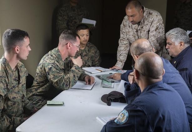 Marines with Task Force Southwest advise and assist Afghan role players at a planning meeting during the full mission rehearsal at forward operating base Bravo, Camp Lejeune, N.C., Feb. 28, 2017. The Marines work with Afghan role players to gain a better cultural understanding before deploying later this year to Helmand Province, Afghanistan.  The Marines are scheduled to deploy as part of the task force to train, advise and assist the Afghan National Army 215th Corps and 505th Zone National Police. (U.S. Marine Corps photo by Sgt. Justin T. Updegraff)