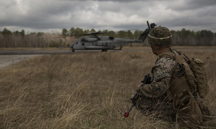 A Marine with Task Force Southwest provides security for a CH-53 super stallion during the full mission rehearsal at forward operating base Bravo, Camp Lejeune, N.C., Feb. 28, 2017. The Marines are scheduled to deploy as part of the task force to train, advise and assist the Afghan National Army 215th Corps and 505th Zone National Police. (U.S. Marine Corps photo by Sgt. Justin T. Updegraff)