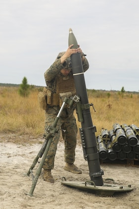 A Marine with Task Force Southwest inserts a round into an 81mm mortar during a live-fire exercise at Camp Lejeune, N.C., March 2, 2017. The exercise was part of the unit's full mission rehearsal, a week-long training event which enhanced the Marines' advisory and combat capabilities. Task Force Southwest is comprised of approximately 300 Marines whose mission will be to train, advise and assist the Afghan National Army 215th Corps and 505th Zone National Police. (U.S. Marine Corps photo by Sgt. Lucas Hopkins)