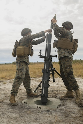 Marines with Task Force Southwest prepare to fire an 81mm mortar during a live-fire exercise at Camp Lejeune, N.C., March 2, 2017. The unit executed a full mission rehearsal from Feb. 27 to March 3, allowing the Marines to build their advisory and combat skills prior to a deployment to Helmand Province, Afghanistan. Task Force Southwest is comprised of approximately 300 Marines, whose mission will be to train, advise and assist the Afghan National Army 215th Corps and 505th Zone National Police. (U.S. Marine Corps photo by Sgt. Lucas Hopkins)