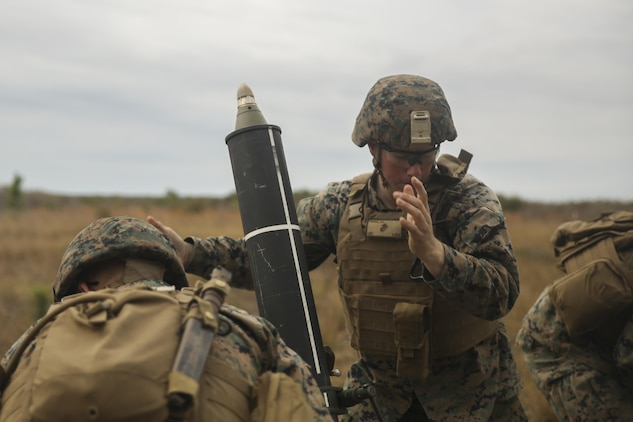 A Marine with Task Force Southwest inserts a round into an 81mm mortar during a live-fire exercise at Camp Lejeune, N.C., March 2, 2017. The exercise was one of several training missions held during the unit's week-long full mission rehearsal, including a Tactical Recovery of Aircraft and Personnel exercise, medical drills and advisory meetings with Afghan role players. Marines with Task Force Southwest are scheduled to deploy to Helmand Province, Afghanistan later this year, where they will train, advise and assist the Afghan National Army 215th Corps and 505th Zone National Police. (U.S. Marine Corps photo by Sgt. Lucas Hopkins)