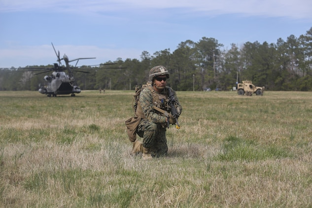 A Marine with Task Force Southwest posts security during a during a Tactical Recovery of Aircraft and Personnel training exercise at Camp Lejeune, N.C., March 2, 2017. From Feb. 27 to March 3, the unit executed a full mission rehearsal to enhance the Marines' advisory and combat skills in preparation for a deployment to Helmand Province, Afghanistan. Task Force Southwest is comprised of approximately 300 Marines, whose mission will be to train, advise and assist the Afghan National Army 215th Corps and 505th Zone National Police. (U.S. Marine Corps photo by Sgt. Lucas Hopkins)