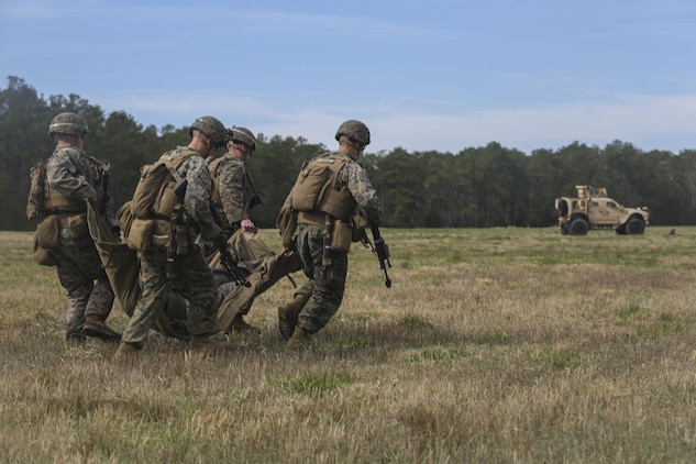 Marines with Task Force Southwest carry a simulated casualty during a Tactical Recovery of Aircraft and Personnel training scenario at Camp Lejeune, N.C., March 2, 2017. The scenario was part of the unit's full mission rehearsal, which bolstered its Marines' combat and advisory skills. Marines with Task Force Southwest are scheduled to deploy to Helmand Province, Afghanistan later this year, where they will train, advise and assist the Afghan National Army 215th Corps and 505th Zone National Police. (U.S. Marine Corps photo by Sgt. Lucas Hopkins)