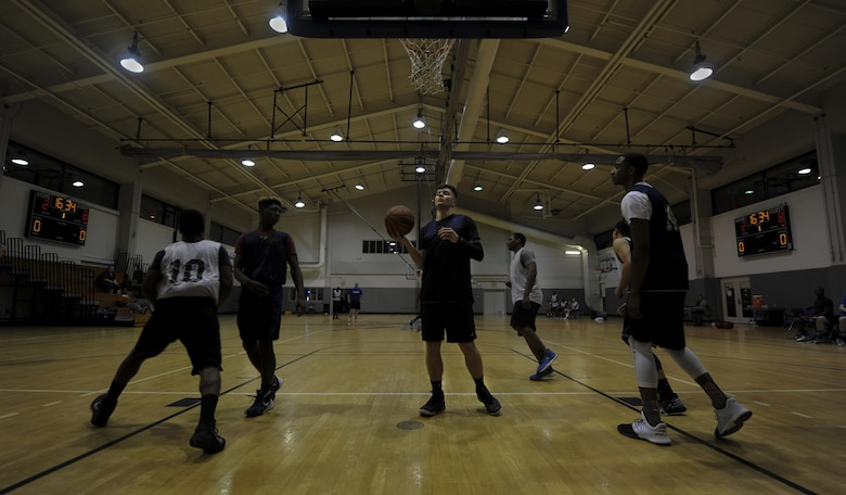 The 1st Special Operations Maintenance Squadron competes against the 1st Special Operations Contracting Squadron during an intramural basketball game at Hurlburt Field, Fla., March 2, 2017. The game consisted of two, 15-minute halves that ended with a win for the 1st SOCONS. (U.S. Air Force photo by Airman 1st Class Dennis Spain)