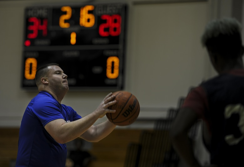 Christopher Rex, a center for the 1st Special Operations Contracting Squadron intramural basketball team, prepares to shoot a free throw during a basketball game at Hurlburt Field, Fla., March 3, 2017. The 1st SOCONS defeated the 1st Special Operations Maintenance Squadron 78-62. (U.S. Air Force photo by Airman 1st Class Dennis Spain)